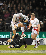 Twickenham, GREAT BRITAIN, James HASKELL, jumps over Richie McCAW, during the second half of the Investic Challenge, England vs New Zealand, Autumn International at Twickenham Stadium, Surrey on Sat 29.11.2008 [Photo, Peter Spurrier/Intersport-images]