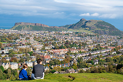 View of Salisbury Crags and Arthur's Seat hill overlooking Edinburgh, Scotland, United Kingdom