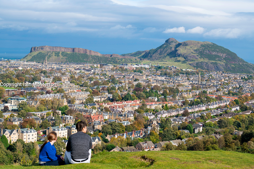 View of Salisbury Crags and Arthur's Seat hill overlooking Edinburgh, Scotland, United Kingdom