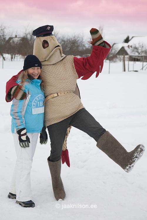 Mascot in Fish Costume Rändur Rääbis  Embracing Young Woman, Tartu County, Estonia