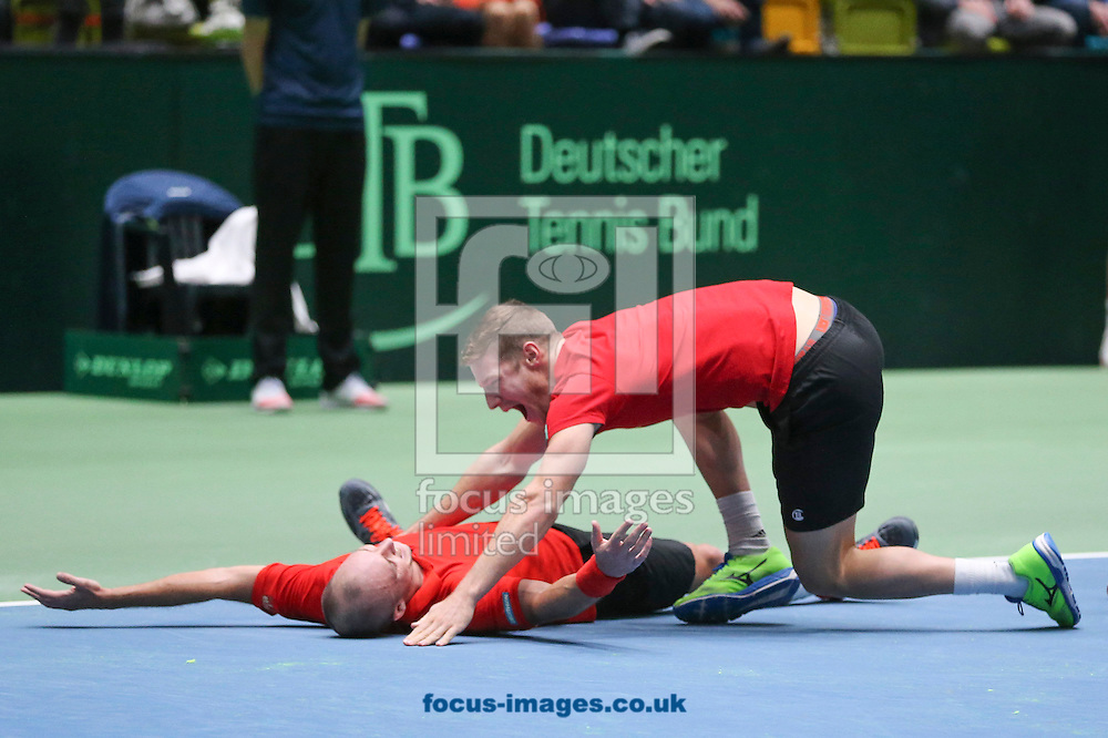 Steve Darcis of Belgium and team mates celebrate after beating Alexander Zverev of Germany to make their score three rubbers to one during the world group first round 2017 Davis Cup match between Germany and Belgium in the Fraport Arena, Frankfurt, Germany.<br /> Picture by EXPA Pictures/Focus Images Ltd 07814482222<br /> 05/02/2017<br /> *** UK &amp; IRELAND ONLY ***<br /> <br /> EXPA-EIB-170205-0222.jpg