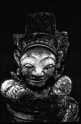 Bali.<br />Small sculpture in a paddy field near Ubud.<br />Copyright: Dominic Sansoni