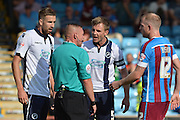 Tony Craig remonstrates with ref during the Sky Bet League 1 match between Scunthorpe United and Millwall at Glanford Park, Scunthorpe, England on 22 August 2015. Photo by Ian Lyall.