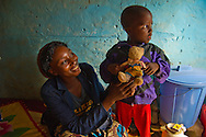Nigeria mother and child at their home in the Kaduna area.