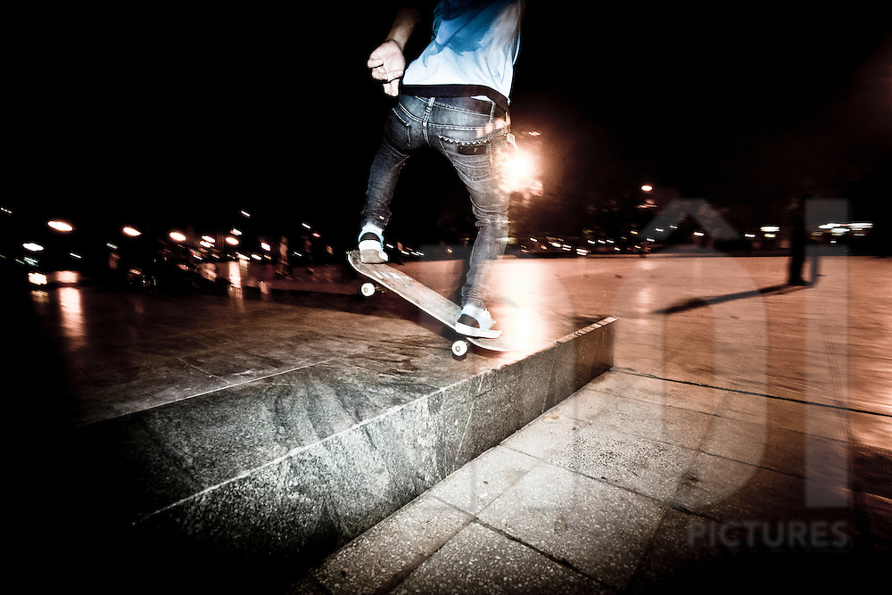Vietnamese young skateboarders practice at night in Lenin Park, Hanoi, Vietnam, Asia