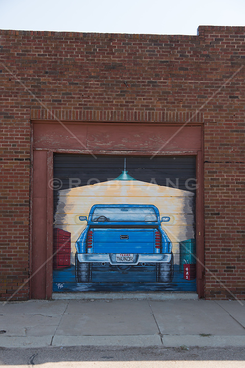 painted truck on a garage door in Texas