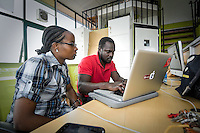 Henry Addo and Linda Kamau, developers for Ushahidi, an open source project which crowdsources crisis information via mobile phones, work out of Nairobi's iHub. Ushahidi was launch in response to Kenya's 2008 post-election violence, and is now used as a platform for crowdsourcing information from all over the world.