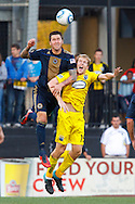 24 OCTOBER 2010:  Philadelphia Union defender Danny Califf (4) heads the ball over Columbus Crew midfielder Kevin Burns (15) during MLS soccer game at Crew Stadium in Columbus, Ohio on August 28, 2010.