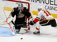 Calgary Flames forward Matt Stajan (R) tries to get a shot in on Anaheim Ducks goalie John Gibson during a 2017-2018 NHL hockey game in Anaheim, California, the United States, on Oct. 9, 2017.  Calgary Flames won 2-0. (Xinhua/Zhao Hanrong)