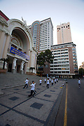 Morning Tai Chi in front of Municipal Theatre/Opera House, Caravelle (m.) and Sheraton Hotels.