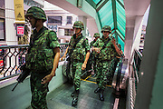 25 MAY 2014 - BANGKOK, THAILAND: Thai soldiers on patrol in the Bangkok BTS Skytrain system. Public opposition to the military coup in Thailand grew Sunday with thousands of protestors gathering at locations throughout Bangkok to call for a return of civilian rule and end to the military junta.     PHOTO BY JACK KURTZ