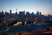Darling harbour at dawn. South Steyne former passenger ship serving as a function centre (l.), Sydney Tower and Centre.