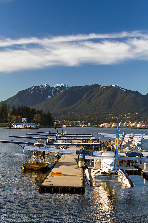 Seaplanes at the Vancouver Harbour Flight Center at Coal Harbour in Vancouver, British Columbia, Canada.  The Vancouver Harbour Flight Centre was previously known as the Vancouver Harbour Water Airport and the Coal Harbour Seaplane Base. The City of North Vancouver and Grouse Mountain can be seen in the background.