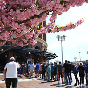 Fans queue for entry to Citi Field on a spring day before the New York Mets Vs Washington Nationals MLB regular season baseball game at Citi Field, Queens, New York. USA. 3rd May 2015. Photo Tim Clayton