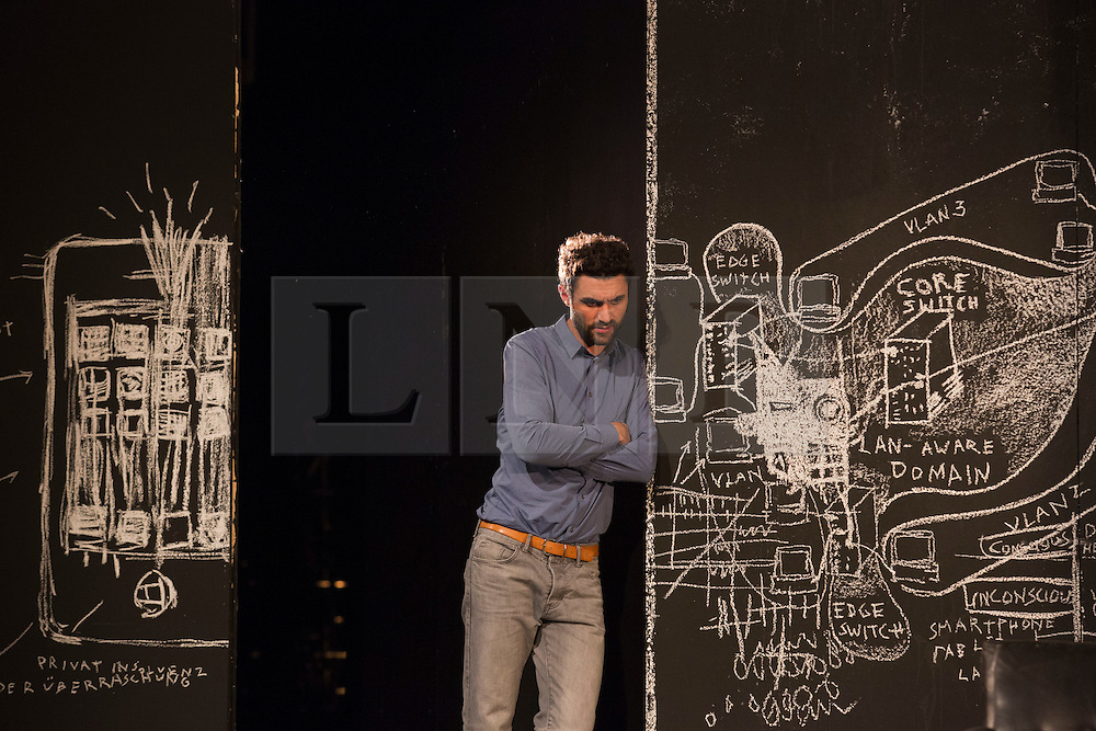 """© Licensed to London News Pictures. 24/09/2014. London, England. Pictured: Renato Schuch as Hovath. German theatre company Schaubühne Berlin present an adaptation of """"An Enemy of the People"""" by Henrik Ibsen at the Barbican Theatre, Barbican Centre, from 24-28 September 2014. The play is directed by Thomas Ostermeier and part of the International Ibsen Season. Photo credit: Bettina Strenske/LNP"""