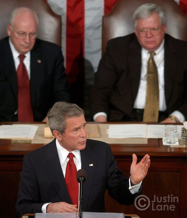 United States President George W. Bush delivers his 2005 State of the Union Address at the US Capitol in Washington DC 2 February 2005. Behind him is Vice President Richard Cheney (L) and Speaker of the House Dennis Hastert (R).