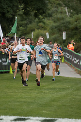 Joe Harrington races other runners in the final stretch of race