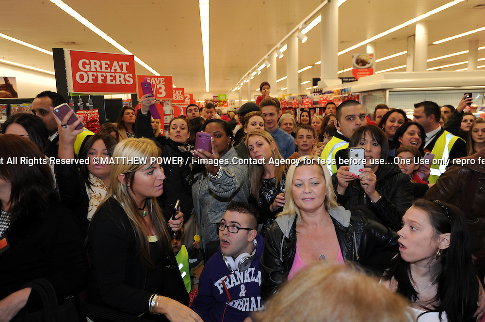 Crowds gather to see Peter Andre signs copies of his new album at the Sainsbury store in London Colney near St Albans,Hertfordshire. Monday October 29, 2012. Photo by Matthew Power / i-Images