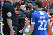 Walsall manager Jon Whitney discusses with the referee about the injury between Walsalls Jason McCarthy and Eoghan O'Connell during the EFL Sky Bet League 1 match between Walsall and Oldham Athletic at the Banks's Stadium, Walsall, England on 4 March 2017. Photo by Jacqueline Theodosi.