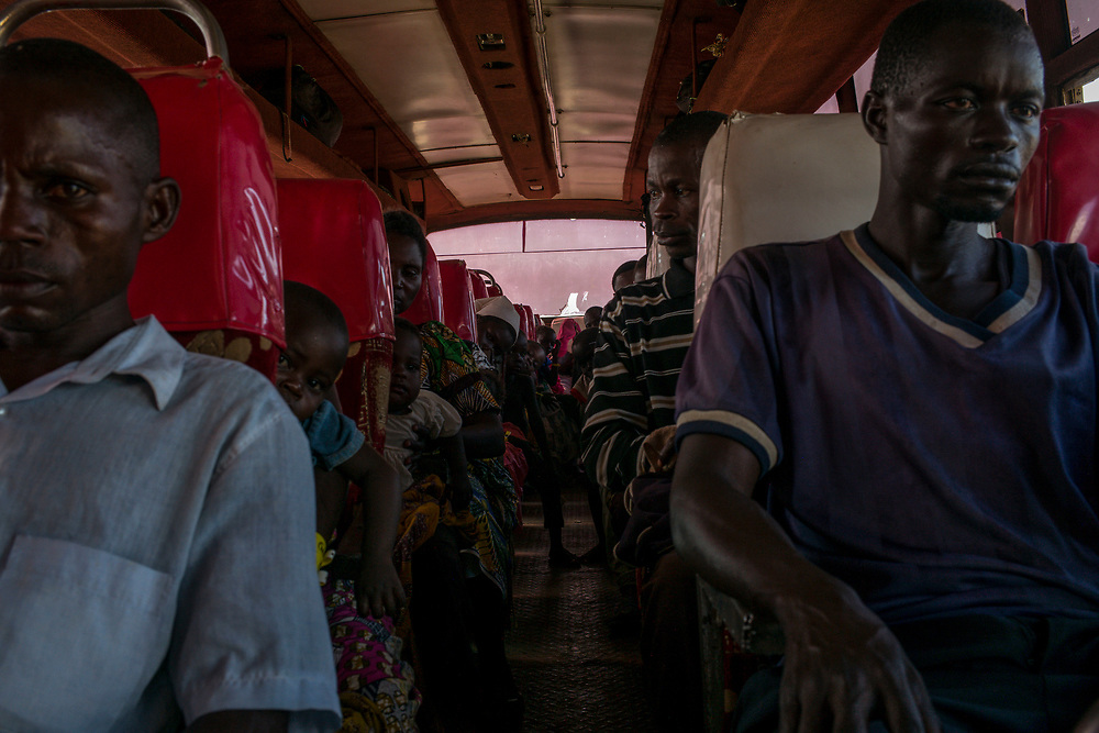 SEBAGORO, UGANDA - MARCH 22: Congolese refugees board a bus bound for Kyangwali refugee settlement camp after landing in Sebagoro, Uganda on March 22, 2018. Violence in Ituri Province in northeastern Democratic Republic of Congo has displaced more than 100,000 people including approximately 40,000 refugees who have fled to Uganda. (Photo by Andrew Renneisen for The Washington Post)