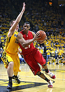 January 27, 2010: Ohio State guard/forward Evan Turner (21) drives around Iowa guard Devan Bawinkel (15) during the first half of their game at Carver-Hawkeye Arena in Iowa City, Iowa on January 27, 2010. Ohio State defeated Iowa 65-57.