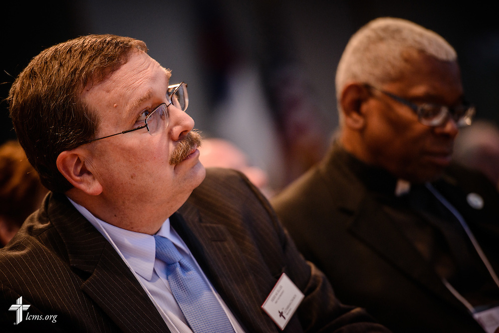 The Rev. Herb Mueller, LCMS first vice-president, listens as the Rev. Dr. Matthew C. Harrison, LCMS president, addresses floor-committee members and Synod staff at the International Center of The Lutheran Church–Missouri Synod on Friday, May 27, 2016, in Kirkwood, Mo. LCMS Communications/Erik M. Lunsford