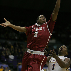 Jan 09, 2010; Baton Rouge, LA, USA; Alabama Crimson Tide guard Mikhail Torrance (2) shoots over LSU Tigers forward Tasmin Mitchell (1) during the second half at the Pete Maravich Assembly Center. Alabama defeated LSU 66-49.  Mandatory Credit: Derick E. Hingle-US PRESSWIRE