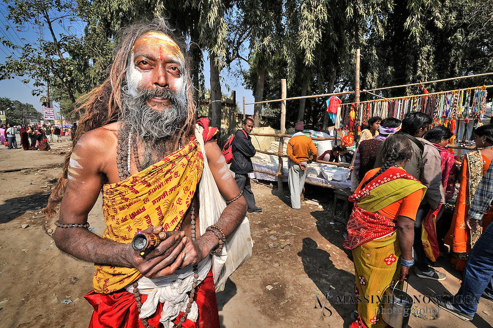 A Sadhu (or Naga Baba) in Allahabd..Sadhu is an ascetic holy man who devotes himself to the goal of moksha or liberation so that soul can overcome the cycle of reincarnation. The Sadhu tradition in India has a long history which can be traced back to the Vedic Age. Such a Hindu ascetic or a monk renounces worldly pleasures in pursuit of higher values of life in order to attain enlightenment. Through strict and hard practice Sadhu detached themselves from  pleasures and pains of human life which makes them indifferent from world and transports them to the metaphysical world..Etymologically Sadhu is a Sanskrit word which means a wise man who renounces the world and all worldly pleasures in quest of spirituality, which ultimately lead them to enlightenment. In order to achieve the zenith of human life they live in caves, temples, forests and hill top, practicing strict code and conduct.