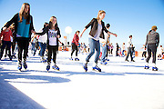 Bondi locals skate on ice on a temporary ice rink during the Winter Festival at Bondi Beach..The Bondi Bergstation showcases the worlds first 500m 2 outdoor ice skating rink by the sea where festival-goers can glide across the ice against the backdrop of the Pacific Ocean, Sydney, Australia 17th July 2010 . An instant sale option is available where a price can be agreed on image useage size. Please contact me if this option is preferred.