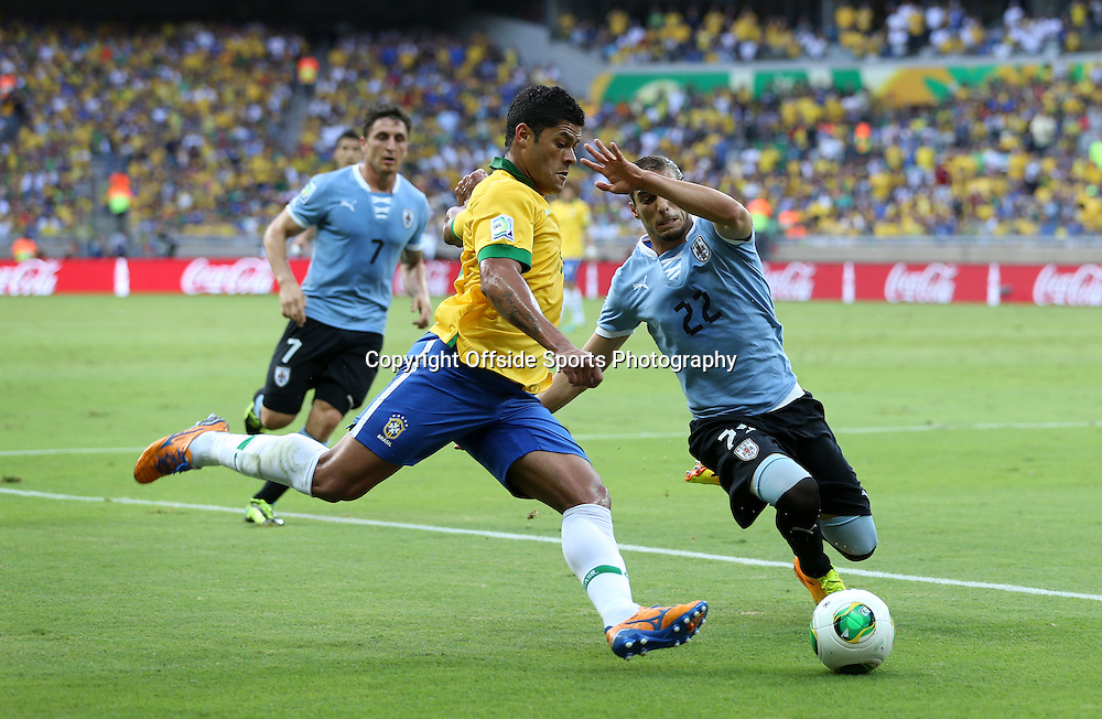 26th June 2013 - FIFA Confederations Cup 2013 (Semi-Final) - Brazil v Uruguay - Martin Caceres of Uruguay tackles Hulk of Brazil - Photo: Simon Stacpoole / Offside.