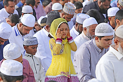 June 26, 2017 - Colombo, Sri Lanka - A Sri Lankan Muslim girl offers prayers amid adult Muslim men during the Eid al-Fitr prayers to mark the end of the holy fasting month of Ramadan in Colombo, Sri Lanka June 26, 2017  (Credit Image: © Tharaka Basnayaka/NurPhoto via ZUMA Press)