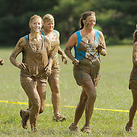 Participants emerge from the mud during the Bluegrass Mud Run, a 5K military-style obstacle course race sponsored by WUKY and the University of Kentucky ROTC in Lexington, Ky., on Saturday, September 22, 2012. Photo by David Stephenson