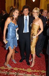 Left to right, FRANCESCA VERSACE, ANDY WONG, and CAROLINE HABIB  at a fashion show and dinner hosted by Shangri-la Hotels and Resorts and Andy Wong featuring fashion by new designer Lu Kun held at The Goldsmiths Hall, Foster Lane, London on 25th April 2005.<br />