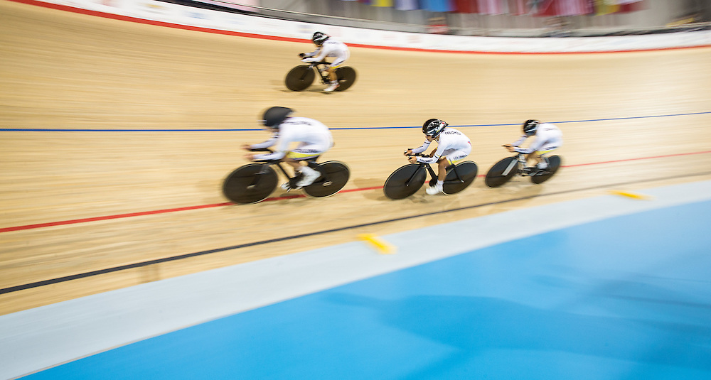 The Colombian team competes in the women's team pursuit qualification on the fist day of track cycling at the 2015 Pan American Games in Toronto, Canada, July 16,  2015.  AFP PHOTO/GEOFF ROBINS