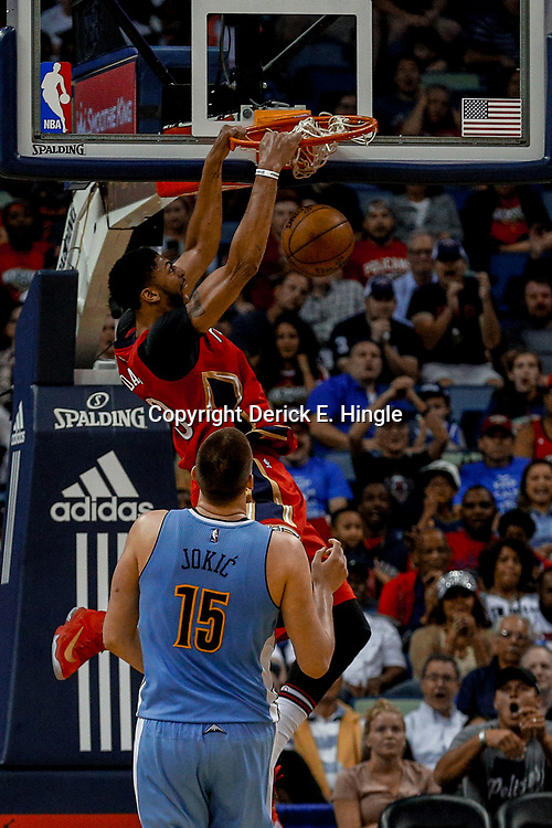 Apr 4, 2017; New Orleans, LA, USA; New Orleans Pelicans forward Anthony Davis (23) dunks over Denver Nuggets forward Nikola Jokic (15) during the second quarter of a game at the Smoothie King Center. Mandatory Credit: Derick E. Hingle-USA TODAY Sports