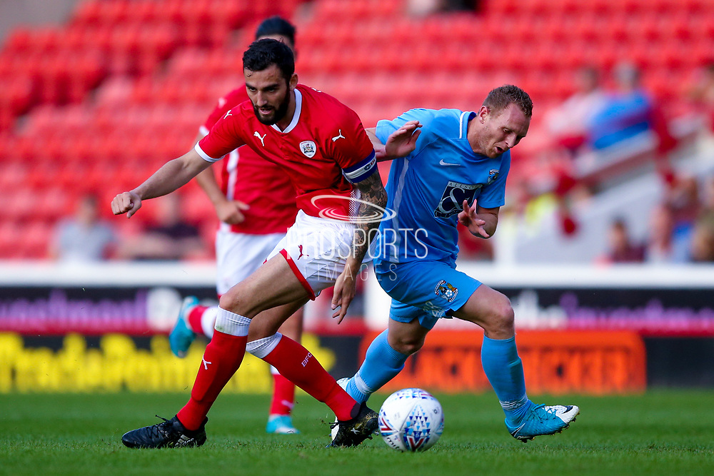 Coventry City forward Stuart Beavon (9) is fouled by the defender during the Pre-Season Friendly match between Barnsley and Coventry City at Oakwell, Barnsley, England on 18 July 2017. Photo by Simon Davies.