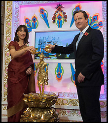 The Prime Minister David Cameron with his wife Samantha during a visit to Neasden Temple for Diwali celebrations, Neasden Temple, London, United Kingdom. Monday, 4th November 2013. Picture by Andrew Parsons / i-Images