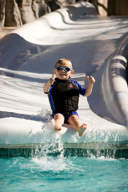 Boy on a water slide.  Palm Springs, California...Boy on a water slide Palm Springs California USAtesttest4551000