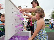 Bridget Fisher (front), 7, and her mother, Renee Fisher, both of Wellman, explore the Water Movement station at the 21st annual Tanager Place Summer Fest at the Rockwell Collins Sports Complex in Cedar Rapids on Saturday afternoon, June 4, 2011. Activities included the General Mills Make-Your-Own Cereal Tent, miniature golf, St. Luke's Hospital bike helmet giveaway, Video Game Etc tent, forty free kids' crafts and displays, a car show, and music. All proceeds from the event went to Tanager Place.