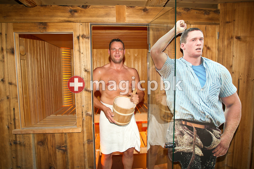 Swiss wrestling star Noeldi (Arnold) FORRER of Switzerland is taking a sauna at his home in Stein (SG), Switzerland, Friday, May 6, 2011. FORRER is being watched by a cardboard figure of Kilian WENGER, the current king of the Swiss national sport of Schwingen (swiss wrestling). (Photo by Patrick B. Kraemer / MAGICPBK)