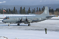 RCAF CP-140 Aurora being parked by a marshaller