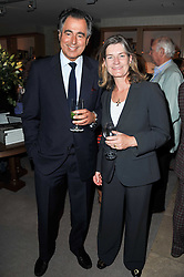 EMILY TODHUNTER and MANOLI OLYMPITIS at a party to celebrate the publication of 'Garden' by Randle Siddeley held at Linley, 60 Pimlico Road, London on 24th May 2011.