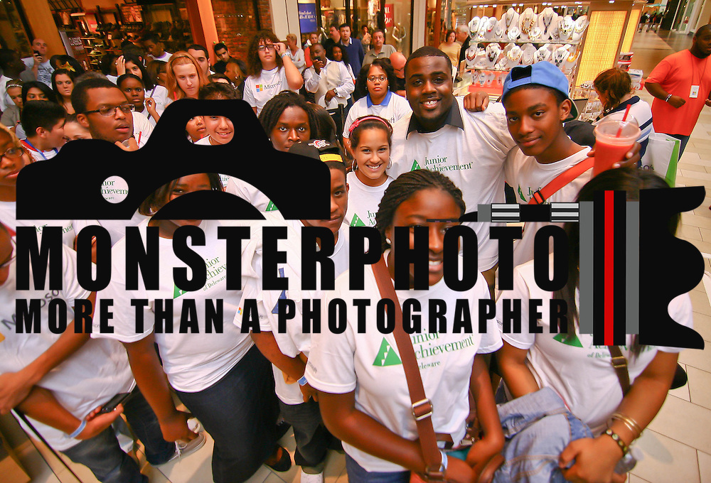A group of Junior Achievement students of Delaware pose for a picture while waiting online for the New Microsoft store open Saturday, Sept. 29 2012, at Christiana Mall in Newark DE...