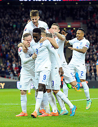 Danny Welbeck of England (Arsenal) celebrates  scoring  his first goal of the game with team mates    - Photo mandatory by-line: Joe Meredith/JMP - Mobile: 07966 386802 - 15/11/2014 - SPORT - Football - London - Wembley - England v Slovenia - EURO 2016 Qualifier