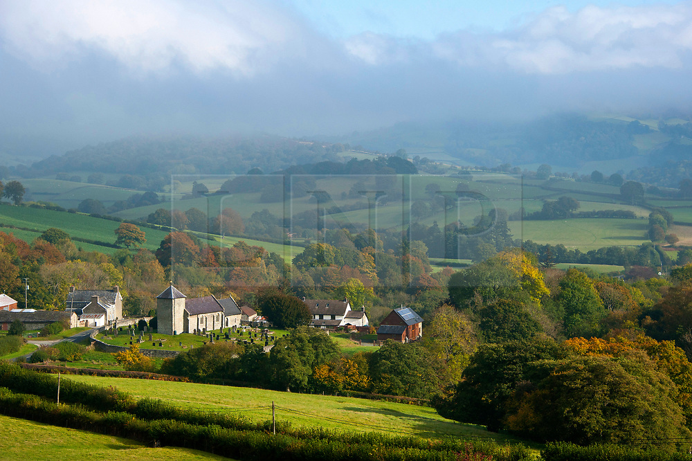 © Licensed to London News Pictures. 23/10/2019. Llanddewi'r Cwm, Powys, Wales, UK. After a very cold night with temperatures dropping to around 1.5 deg C, St David's Church in the small village of Llanddewi'r Cwm is surrounded by mist. Photo credit: Graham M. Lawrence/LNP
