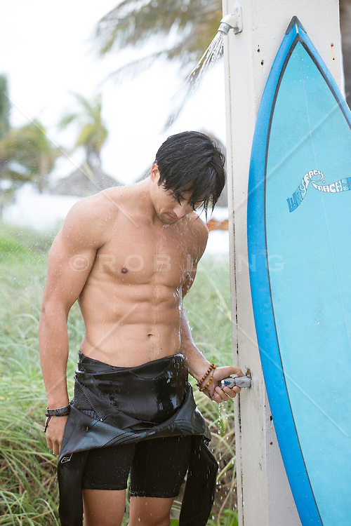 sexy surfer showering off at the beach in Florida
