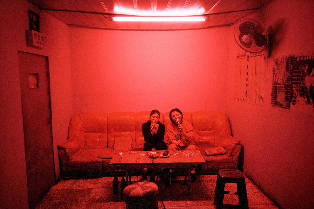 Karaoke hostesses. Sino Russian North Korean Tri-border.  Hunchun, China. 2002