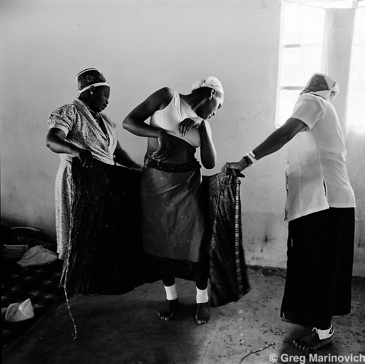 Ekuphakameni, KwaZulu Natal. A young girl prepares for her wedding during a mass marriage ceremony at the headquarters of the Nazareth Baptist Church, or Shembe, is a staunchly traditionalist Zulu cult that was founded in 1913 by Isiah Shembe after a vision. Their beliefs are a mix of Old and New Testament and the ancestral veneration of traditional Zulu culture.