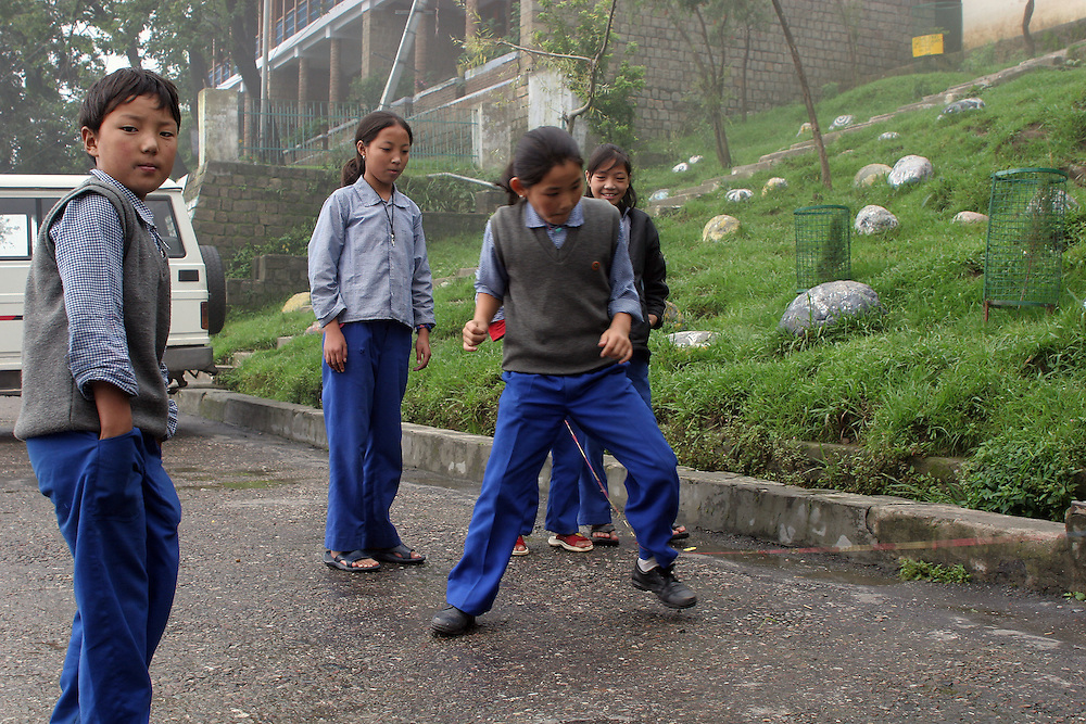 Students play during recess at TCV, the Tibetan Children's Village. McLeod Ganj, Dharamsala, India. 7/29/05.