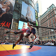 Nate Rose, New York, and Tony Cassas, New Jersey, in action during a warm up fight before the main event,  'Beat The Streets' USA Vs The World, International Exhibition Wrestling in Times Square. New York, USA. 7th May 2014. Photo Tim Clayton
